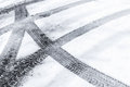 Automotive tire tracks on wet snow fresh Royalty Free Stock Photography