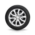 Automotive wheel on gray light alloy disc isolated white background with soft shadow Royalty Free Stock Photo