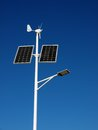 Autonomous street light lamp powered by solar panels and wind turbine Stock Images