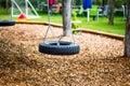 Autoreifen as a swing on a playground,