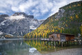 Autumn in alps idyllic lake surrounded by colorful trees the italian Royalty Free Stock Images