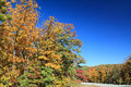 Autumn in arkansas mountains bright sun and dark blue sky over colorful leaves along scenic byway mount magazine state park the Stock Photo