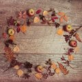 Autumn arrangement of leaves, apples and berries on a wooden background with free space for text. Top view, concept of Royalty Free Stock Photo