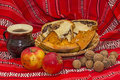 Autumn arrangement traditional romanian sweet bread apples nuts and a mug of wine Stock Photography