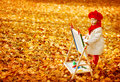 Autumn Baby Artist Painting Fall Yellow Leaves, Creative Kid Royalty Free Stock Photo