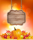 Autumn background with fruit and leaves and wooden sign. Royalty Free Stock Photo