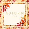 Autumn background with Autumn is here text with autumn leaves and acorns frame