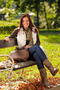 Autumn beautiful woman sit on bench park Royalty Free Stock Photo