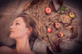 Autumn beauty woman portrait of beautiful girl with leaves and apples in her gorgeous golden hair lying over canvas material Stock Image
