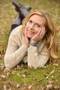 Autumn blond on ground portrait of a pretty in foliage Stock Photo