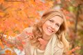 Autumn blond i portrait of a pretty in foliage Royalty Free Stock Photography