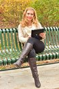 Autumn blond with tablet a pretty enjoying her on an day Royalty Free Stock Image
