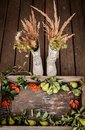 autumn bouquet in old rubber boots. An old wooden box with autumn fruits of black and red mountain ash Royalty Free Stock Photo
