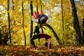Autumn breakdance acrobats frolicking in the park Royalty Free Stock Photography