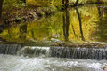 Autumn brook with waterfall peaceful landscape vibrant colors and Royalty Free Stock Photography
