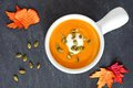 Autumn butternut squash soup on slate background Royalty Free Stock Photo