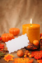 Autumn candles and blank note Stock Images