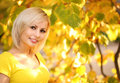 Autumn Cheerful Woman. Blonde Girl and Yellow Leaves. Portrait Royalty Free Stock Photo