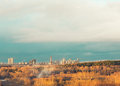 Autumn city on the horizon landscape of ekaterinburg behind forest Royalty Free Stock Image