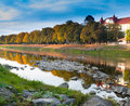 Autumn city landscape with reflection in the river on a sunny day Royalty Free Stock Image