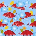 Autumn colorful cartoon vector seamless pattern. Ornamental abstract decorative background. Light blue sky, clouds, rain drops, r