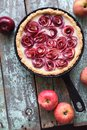 Autumn comfort food. Homemade pie with apple roses with organic Royalty Free Stock Photo