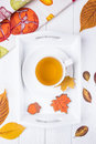 Autumn composition. Herbal tea and autumn gingerbread in the form of maple leaf and acorn on a white background. Top Royalty Free Stock Photo