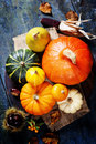 Autumn concept with seasonal fruits and vegetables on wooden board Stock Images