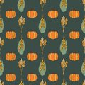 Autumn Corn plant, crop and pumpkins on dark green background seamless repeating vector pattern. Fall harvesting. For Royalty Free Stock Photo