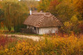 Autumn cottage a wooden situated in an open air museum of village architecture in tokarnia outside kielce poland Stock Images