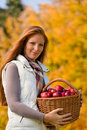Autumn country - woman with wicker basket Royalty Free Stock Photo