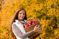Autumn country - woman with wicker basket Royalty Free Stock Image