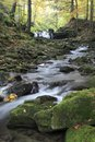Autumn creek flowing blurred water between boulders on an in beskydy mountains czech republic Royalty Free Stock Images