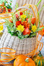 Autumn decoration table with basket and pumpkins Royalty Free Stock Photos