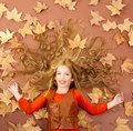 Autumn fall little blond girl on dried tree leaves Royalty Free Stock Photo