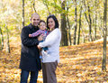 Autumn family at a park in the Stock Photo