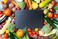 Autumn farm vegetables, root crops and slate cutting board top view with copy space for menu or recipe. Healthy food background. Royalty Free Stock Photo