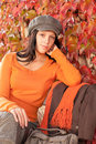 Autumn fashion portrait young woman relax bench Stock Photo