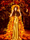 Autumn Fashion Woman Fall Leaves Dress, Outdoor Leaf Coat Royalty Free Stock Photo