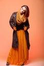Autumn fashion woman fresh girl eye lashes fall in color in full length long false orange Royalty Free Stock Photo