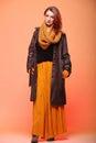 Autumn fashion woman fresh girl eye lashes fall in color in full length long false orange Stock Image