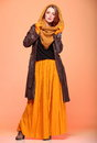 Autumn fashion woman fresh girl eye lashes fall in color in full length long false orange Royalty Free Stock Image