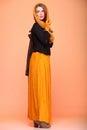 Autumn fashion woman fresh girl eye lashes fall in color in full length long false orange Stock Photo
