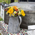 Autumn flowers in an aluminum pitcher Stock Image