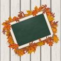 Autumn foliage blackboard wooden background Immagini Stock