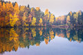 Autumn forest reflected on lake scenic view of at sunrise Stock Photo