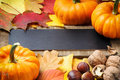 Autumn frame with pumpkins, walnuts and leaves Royalty Free Stock Photography