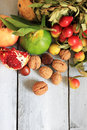 Autumn fruits photo of on wooden background Royalty Free Stock Photos