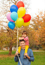 Autumn fun father and son having outdoors Royalty Free Stock Image