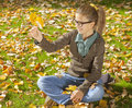 Autumn fun young girl in park Stock Photo